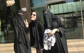 TEI's Jennifer Wesselhoff (center) poses in the Kingdom of Saudi Arabia with two Saudi Arabian friends.
