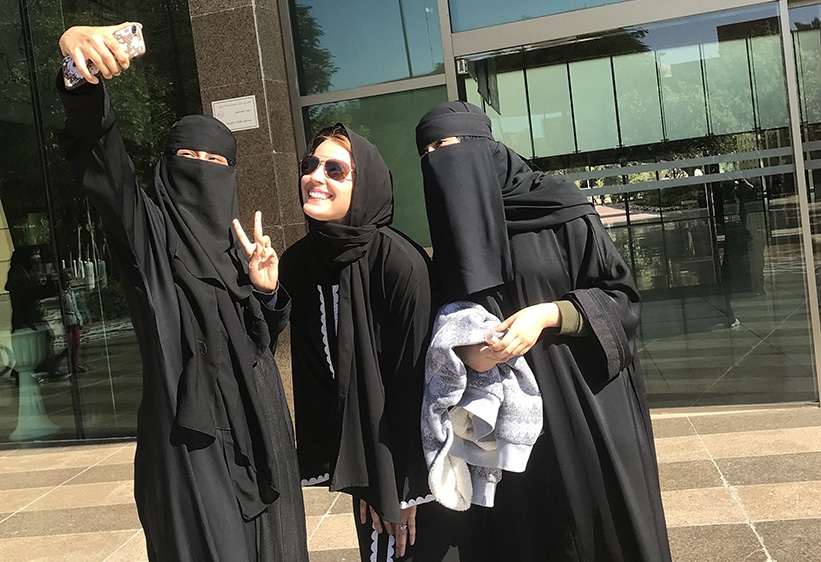 TEI's Jennifer Wesselhoff (center) poses in Alu Ula with two Saudi Arabian friends.